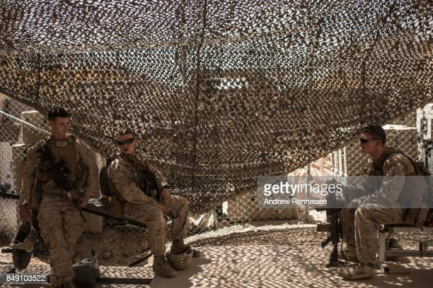 S marines rest on benches in the gym at Camp Bost on September 11 2017 in Helmand Province Afghanistan About 300 marines are currently deployed in...