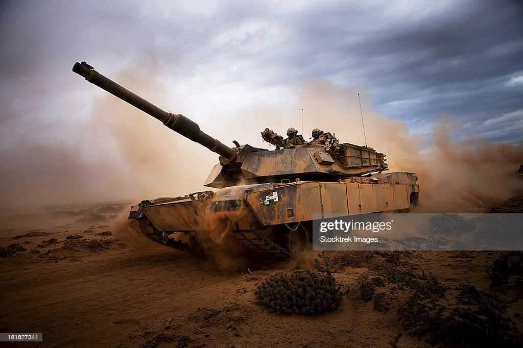 Marines roll down a dirt road on their M1A1 Abrams Main Battle Tank during a day of training at Exercise Africa Lion 2012.