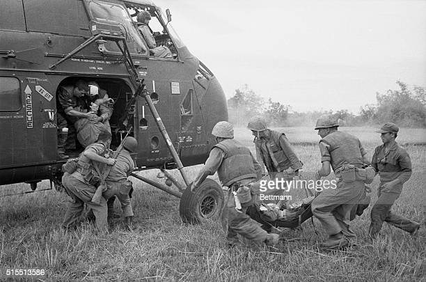 US Marines rush wounded comrades to a waiting evacuation chopper during the last day of the sweeping operation which netted more than 600 Viet Cong...