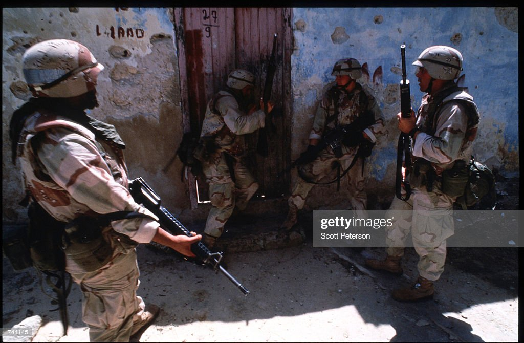 S Marines search for weapons and ammunition January 11 1993 in Mogadishu Somalia The United Nations hopes to restore order and save hundreds of...