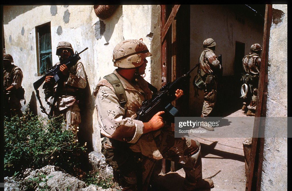 US marines search for weapons and ammunition January 11 1993 Mogadishu Somalia The United Nations hopes to restore order and save hundreds of...