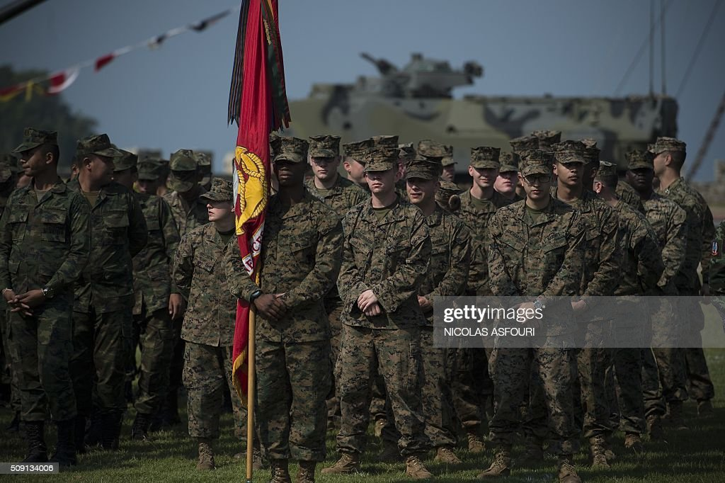 US Marines stand in formation during the opening ceremony of the annual Cobra Gold 2016 military exercises in Sattahip on February 9, 2016. Thailand and the US jointly host Cobra Gold, Asia's largest military exercise, from February 9 to 20. AFP PHOTO / Nicolas ASFOURI / AFP / NICOLAS ASFOURI