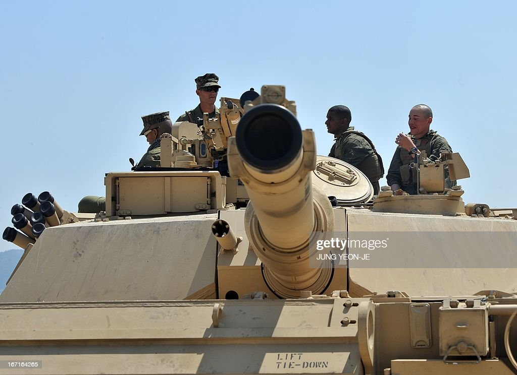 US Marines stand on the top of an M1A1 tank at a beach during the Combined Joint Logistics Over the Shore (CJLOTS) exercise in Pohang, 260 kms southeast of Seoul, on April 22, 2013. The wait for North Korea's expected missile test, which has kept South Korean and US forces on heightened alert for the past two weeks, may stretch to July, the South's defence ministry said on April 22.