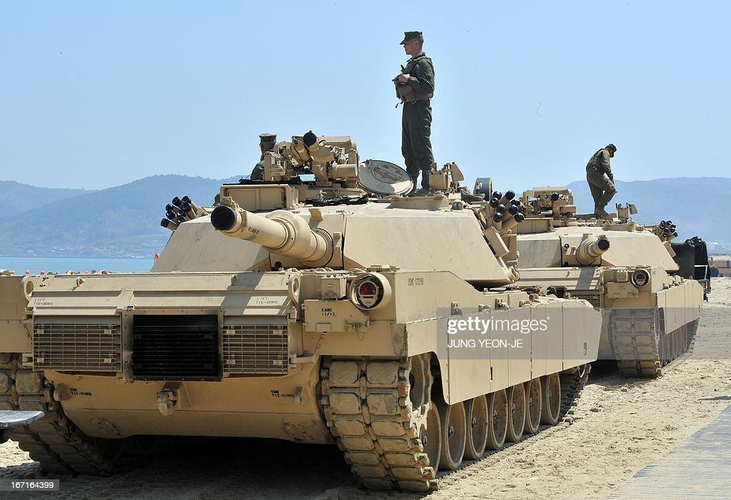 US Marines stand on the top of M1A1 tanks at a beach during the Combined Joint Logistics Over the Shore (CJLOTS) exercise in Pohang, 260 kms southeast of Seoul, on April 22, 2013. The wait for North Korea's expected missile test, which has kept South Korean and US forces on heightened alert for the past two weeks, may stretch to July, the South's defence ministry said on April 22. AFP PHOTO / JUNG YEON-JE