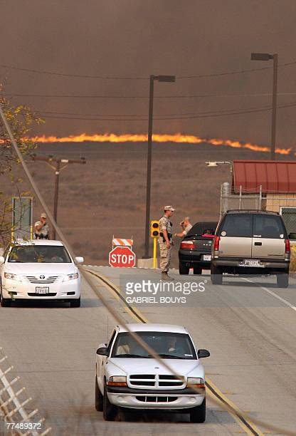 Marines stop cars at the entrance of Camp Pendlenton California 24 October 2007 More than half a million people were ordered to evacuate their homes...