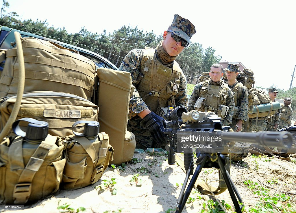 US Marines take a rest at a beach during the Combined Joint Logistics Over the Shore (CJLOTS) exercise in Pohang, 260 kms southeast of Seoul, on April 22, 2013. The wait for North Korea's expected missile test, which has kept South Korean and US forces on heightened alert for the past two weeks, may stretch to July, the South's defence ministry said on April 22.
