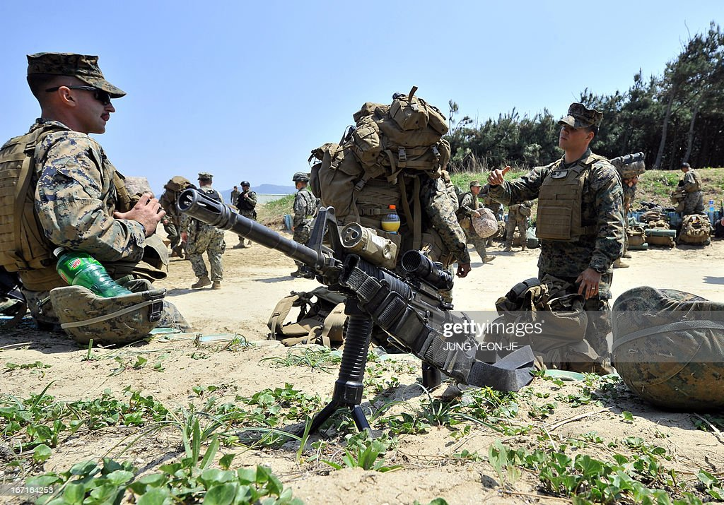 US Marines take a rest at a beach during the Combined Joint Logistics Over the Shore (CJLOTS) exercise in Pohang, 260 kms southeast of Seoul, on April 22, 2013. The wait for North Korea's expected missile test, which has kept South Korean and US forces on heightened alert for the past two weeks, may stretch to July, the South's defence ministry said on April 22. AFP PHOTO / JUNG YEON-JE