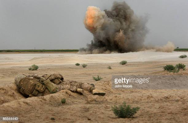 S Marines take cover as a roadside bomb explodes on March 21 2009 near the remote village of Baqwa Afghanistan Marines from the Explosive Ordnance...