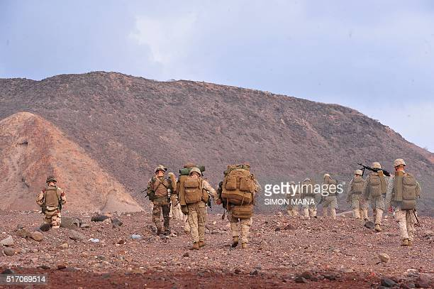 US Marines take part in a military drill on the Golfe of Tadjoura beach in Djibouti on March 23 2016 / AFP / SIMON MAINA