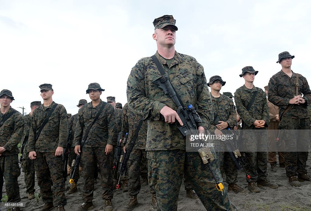 US Marines take part in a mock beach assault as part of Cooperation Afloat Readiness and Training along the beach at a Philippine naval training base...