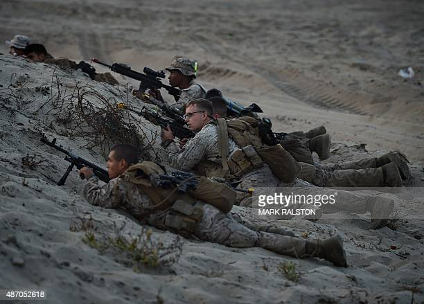 US Marines take their positions during an amphibious landing operation with the Japan Maritime SelfDefense Force at the Dawn Blitz 2015 exercise in...