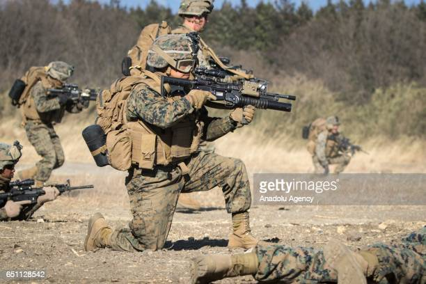 Marines take up defensive position as they train with Japan's Ground Self Defense Force in a joint training drill in JGSDF Camp Soumagahara Gunma...
