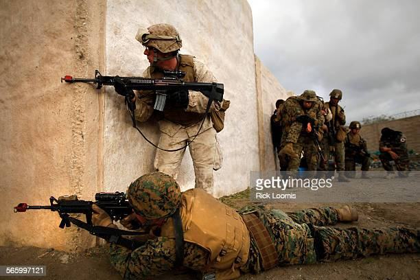 Marines try to safely evacuate their 'wounded' during a mock training exercise in 'Jafarani' – a fake village built at Camp Pendleton to simulate a...