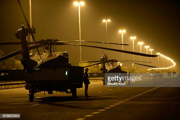 Marines wait for the arrival of US President George W Bush as two Marine One helicopters are parked on a closedoff road near Sowaihan in the United...