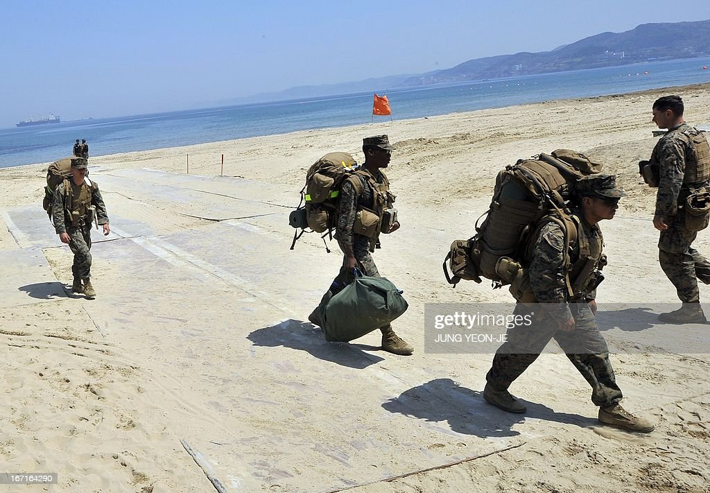 US Marines walk across the beach during the Combined Joint Logistics Over the Shore (CJLOTS) exercise in Pohang, 260 kms southeast of Seoul, on April 22, 2013. The wait for North Korea's expected missile test, which has kept South Korean and US forces on heightened alert for the past two weeks, may stretch to July, the South's defence ministry said on April 22.