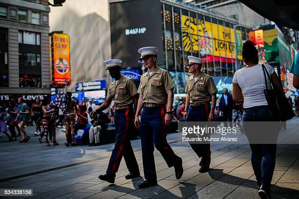 Marines walk around Times Square during Fleet Week on May 25 2016 in New York City Nearly 4500 Sailors Marines and Coast Guardsmen will participate...