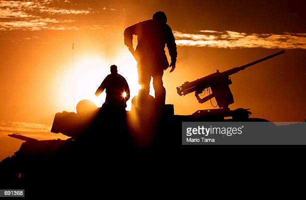 S Marines walk on top of their Light Armored Vehicles while on patrol near the American military compound at Kandahar Airport January 16 2002 in...