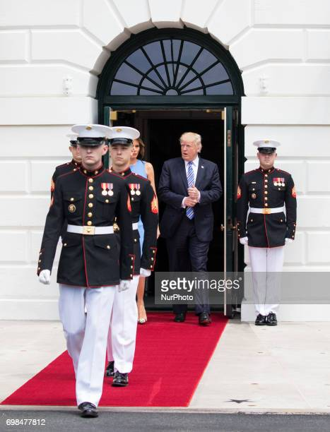 Marines walk out ahead of President Donald Trump and First Lady Melania Trump to prepare for the arrival of President Juan Carlos Varela and Mrs...