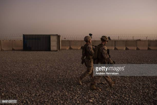 S marines walk to guard stations at Camp Shorab on September 11 2017 in Helmand Province Afghanistan About 300 United States Marines are currently...