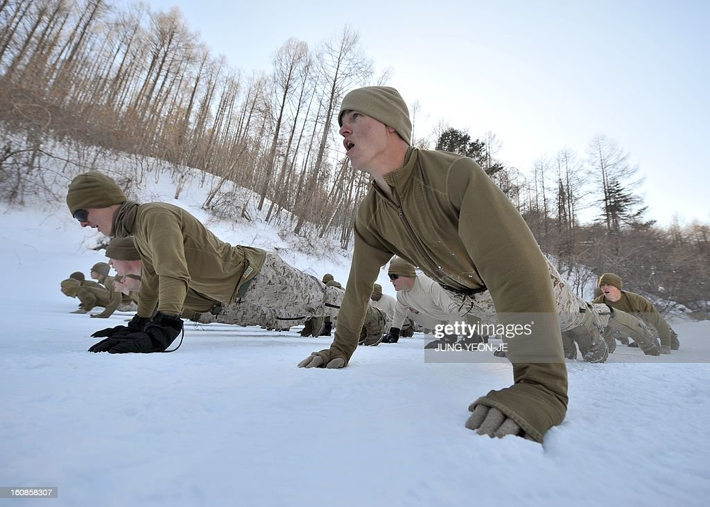 US Marines warm up during a joint winter drill in Pyeongchang, some 180 kilometers east of Seoul, on February 7, 2013. Marines from South Korea and the United States took part in a military winter drills, which began on February 4 and run through February 22, to test their limits in extreme conditions.