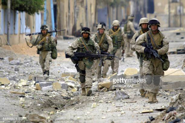 US marines with 3/5 marines Kilo company patrol the city of Fallujah 17 November 2004 west of Baghdad Eleven bodies were collected today from the...