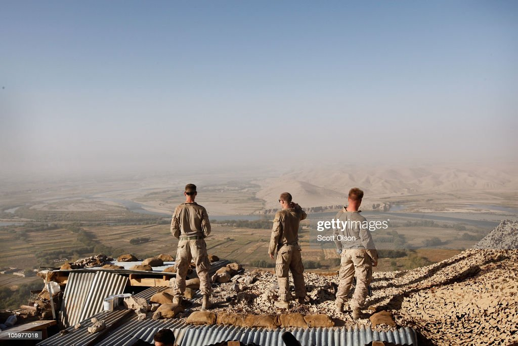 U.S. Marines with India Battery, 3rd Battalion, 12th Marine Regiment looks out over the Helmand River from outpost West perched above Forward Operating Base (FOB) Zeebrugge on October 23, 2010 in Kajaki, Afghanistan. The Marines of India Battery, 3rd Battalion, 12th Marine Regiment are responsible for securing the area near the Kajaki Dam on the Helmand River. The Battery has engaged the enemy 134 times in 164 days.