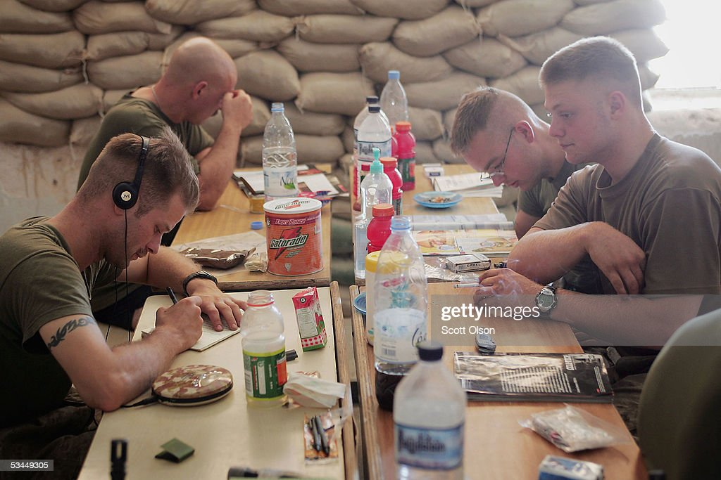 U S Marines with India Company 3rd Battalion 25th Marine Regiment read magazines and write letters home during a break in their barracks on August 22...