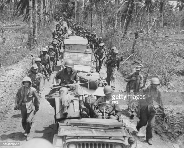 US marines with Japanese prisoners of war during the Pacific Campaign of World War Two Guam circa 19431945