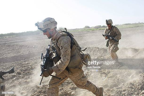 S Marines with the 2nd Marine Expeditionary Brigade RCT 2nd Battalion 8th Marines Echo Co run across a field as they move into position while they...