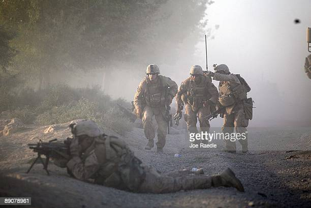 S Marines with the 2nd Marine Expeditionary Brigade RCT 2nd Battalion 8th Marines Echo Co move into position while they were under enemy fire on July...