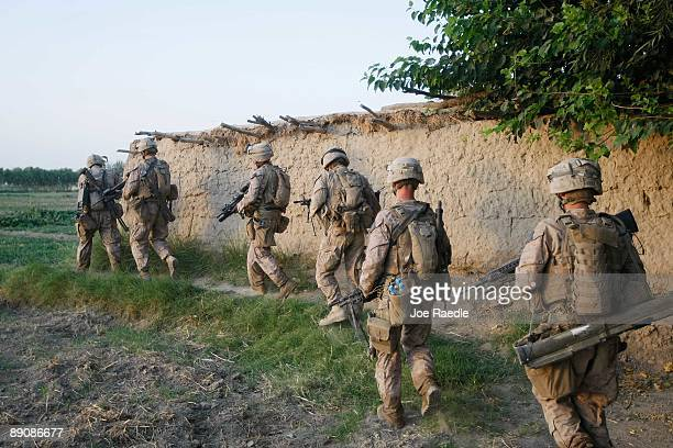 S Marines with the 2nd Marine Expeditionary Brigade RCT 2nd Battalion 8th Marines Echo Co prepare to search a home during an operation to push out...
