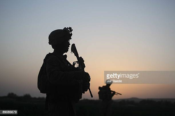 S Marines with the 2nd Marine Expeditionary Brigade RCT 2nd Battalion 8th Marines Echo Co step off in the early morning during an operation to push...