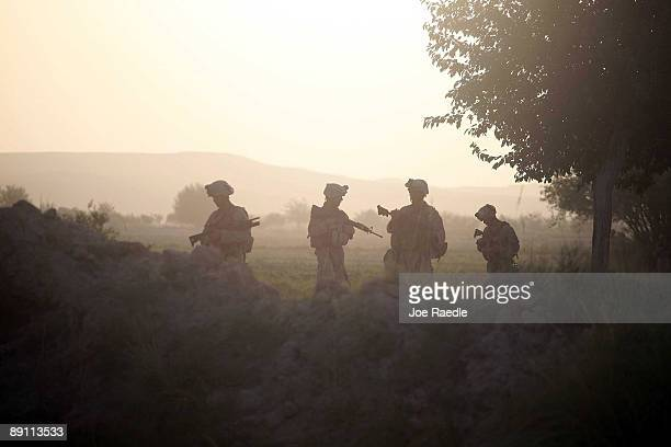 S Marines with the 2nd Marine Expeditionary Brigade RCT 2nd Battalion 8th Marines Echo Co conduct a movement to push Taliban fighters out on July 19...