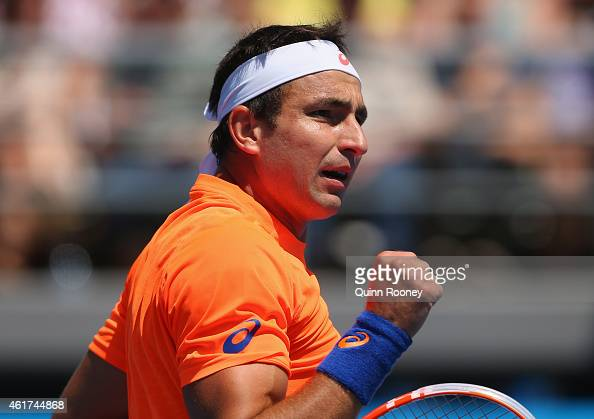 Marinko Matosevic of Australia celebrates a point in his first round match against Alexander Kudryavtsev of Russia during day one of the 2015...