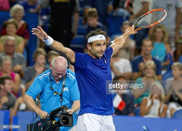 Marinko Matosevic of Australia celebrates his victory against Benoit Paire of France after their eighth session men's singles match on day four of...
