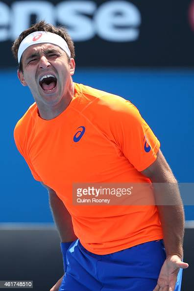 Marinko Matosevic of Australia celebrates winning his first round match against Alexander Kudryavtsev of Russia during day one of the 2015 Australian...