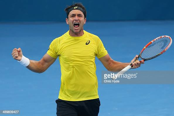 Marinko Matosevic of Australia celebrates winning his match against Sam Querrey of the USA during day four of the 2014 Brisbane International at...