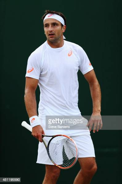 Marinko Matosevic of Australia during his Gentlemen's Singles second round match against Jeremy Chardy of France on day three of the Wimbledon Lawn...