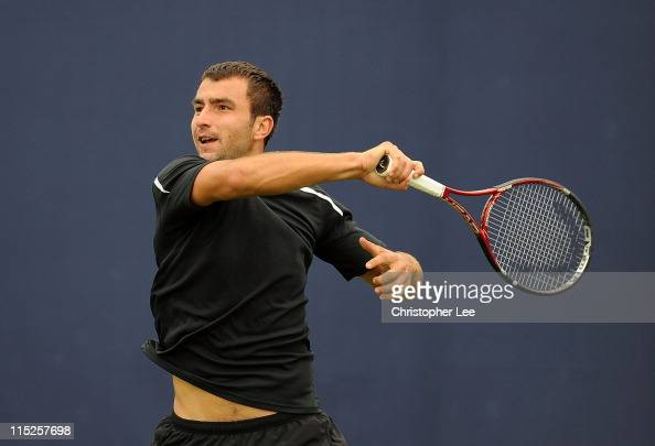 Marinko Matosevic of Australia in action against Ilija Bozoljac of Serbia during Round Three of Qualifying for the AEGON Championship at Queens Club...