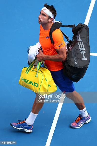 Marinko Matosevic of Australia leaves the court after losing in his second round match against Andy Murray of Great Britain during day three of the...