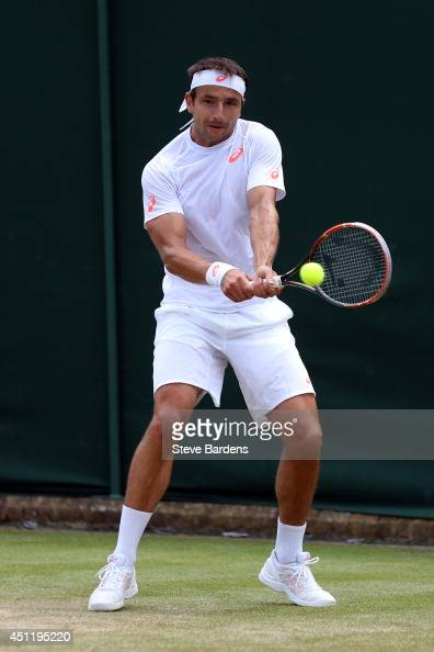 Marinko Matosevic of Australia plays a backhand during his Gentlemen's Singles second round match against Jeremy Chardy of France on day three of the...