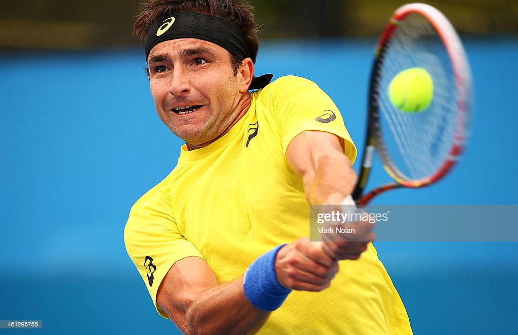 Marinko Matosevic of Australia plays a backhand in his match against Andreas Seppi of Italy during day four of the 2014 Sydney International at Sydney Olympic Park Tennis Centre on January 8, 2014 in Sydney, Australia.