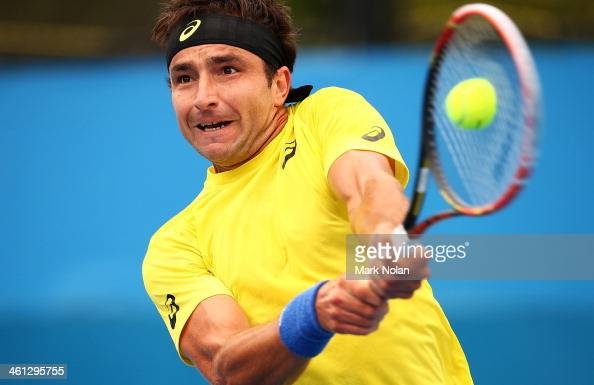 Marinko Matosevic of Australia plays a backhand in his match against Andreas Seppi of Italy during day four of the 2014 Sydney International at...