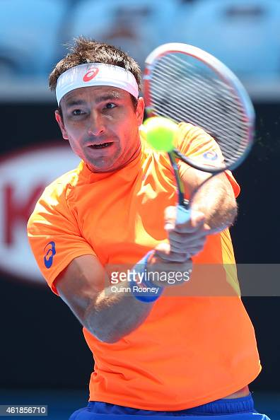 Marinko Matosevic of Australia plays a backhand in his second round match against Andy Murray of Great Britain during day three of the 2015...