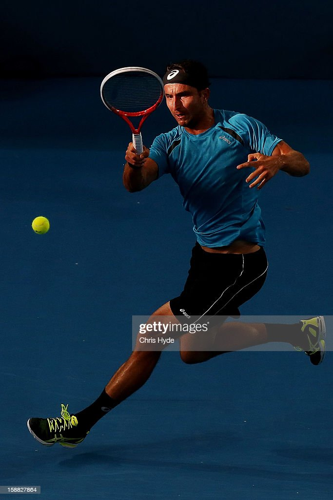 Marinko Matosevic of Australia plays a forehand in his match against Kei Nishikori of Japan during day two of the Brisbane International at Pat Rafter Arena on December 31, 2012 in Brisbane, Australia.