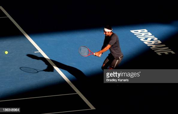 Marinko Matosevic of Australia plays a shot against Tommy Haas of Germany during day three of the 2012 Brisbane International at Pat Rafter Arena on...