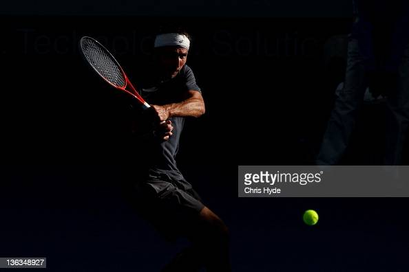 Marinko Matosevic of Australia plays a shot against Tommy Hass of Germany during day three of the 2012 Brisbane International at Pat Rafter Arena on...