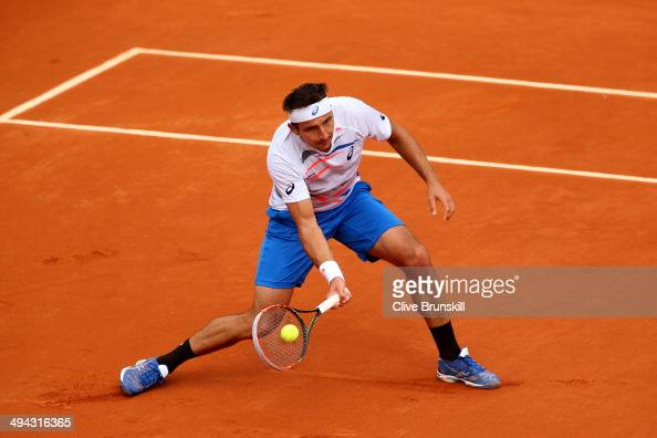 Marinko Matosevic of Australia returns a shot durng his men's singles match against Andy Murray of Great Britain on day five of the French Open at...