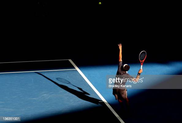Marinko Matosevic of Australia serves against Tommy Haas of Germany during day three of the 2012 Brisbane International at Pat Rafter Arena on...
