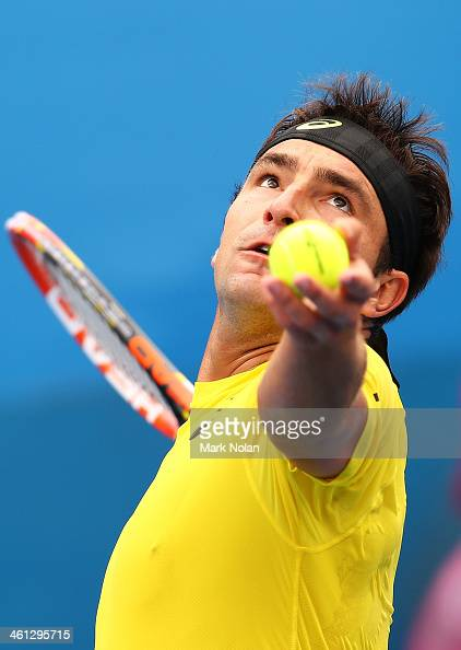 Marinko Matosevic of Australia serves in his match against Andreas Seppi of Italy during day four of the 2014 Sydney International at Sydney Olympic...